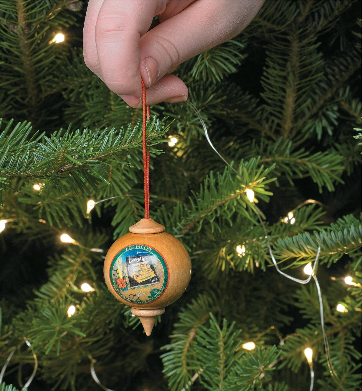 Hanging a First Product Ornament on a Christmas tree