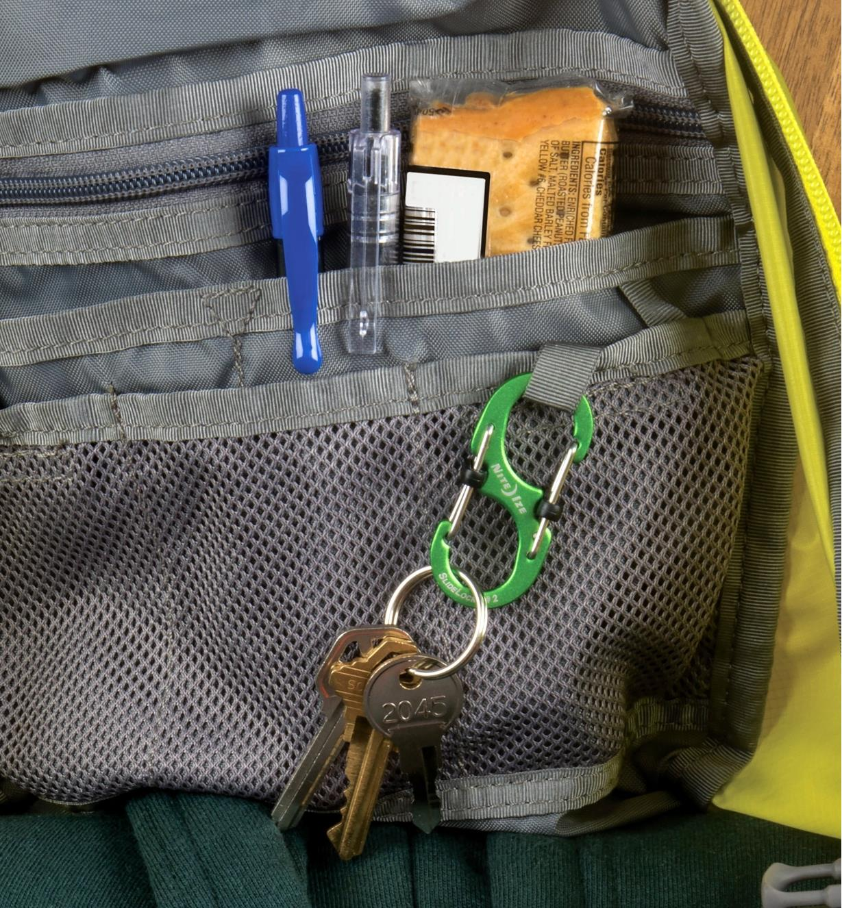 Aluminum S-Biner carabiner with locking gate closures clipped inside a backpack, holding keys