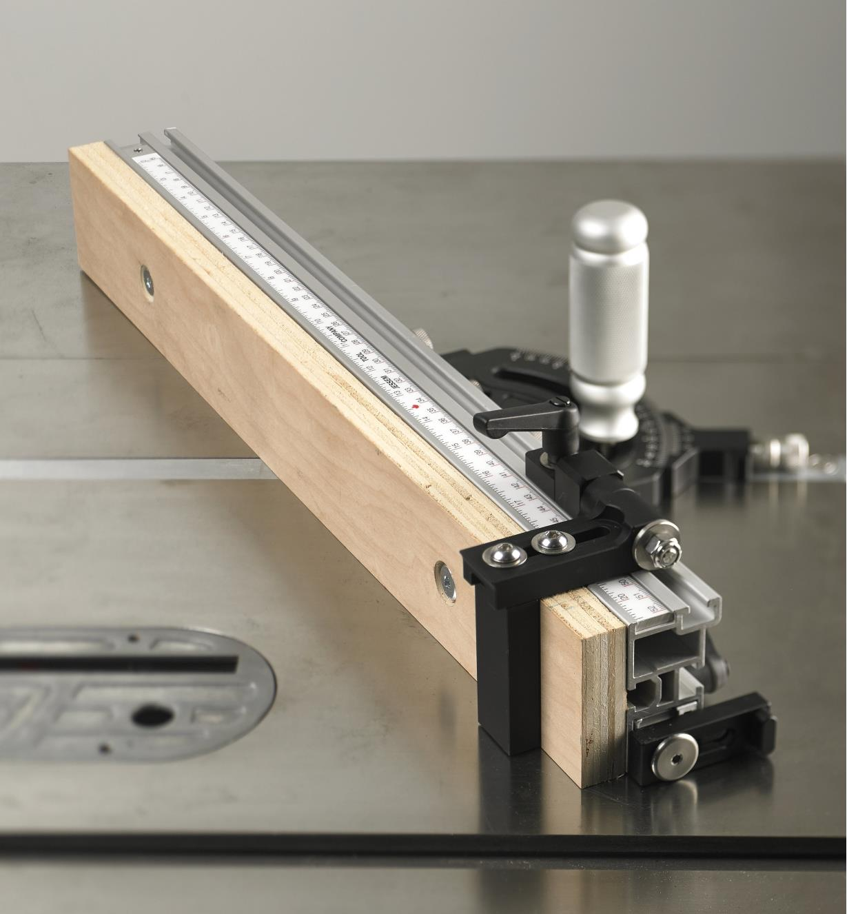 Adjustable flip stop and user-made sacrificial sub-fence mounted on the JessEm Mite-R-Excel II Miter Gauge for repetitive machining