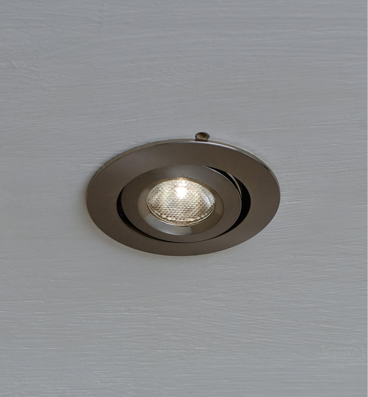 "2"" Natural White LED Spotlight installed in a ceiling"