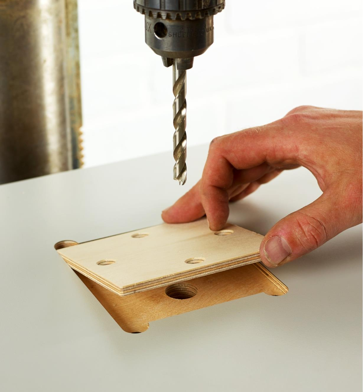 Setting the removable wooden insert into the table top to support through-drilling
