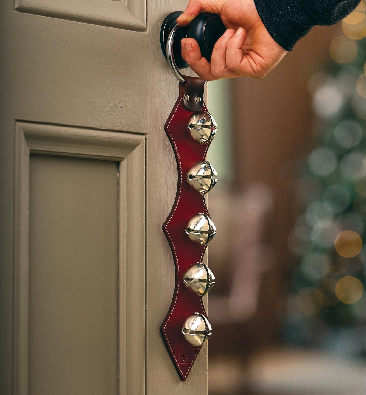 The five-bell hanger hangs from a doorknob