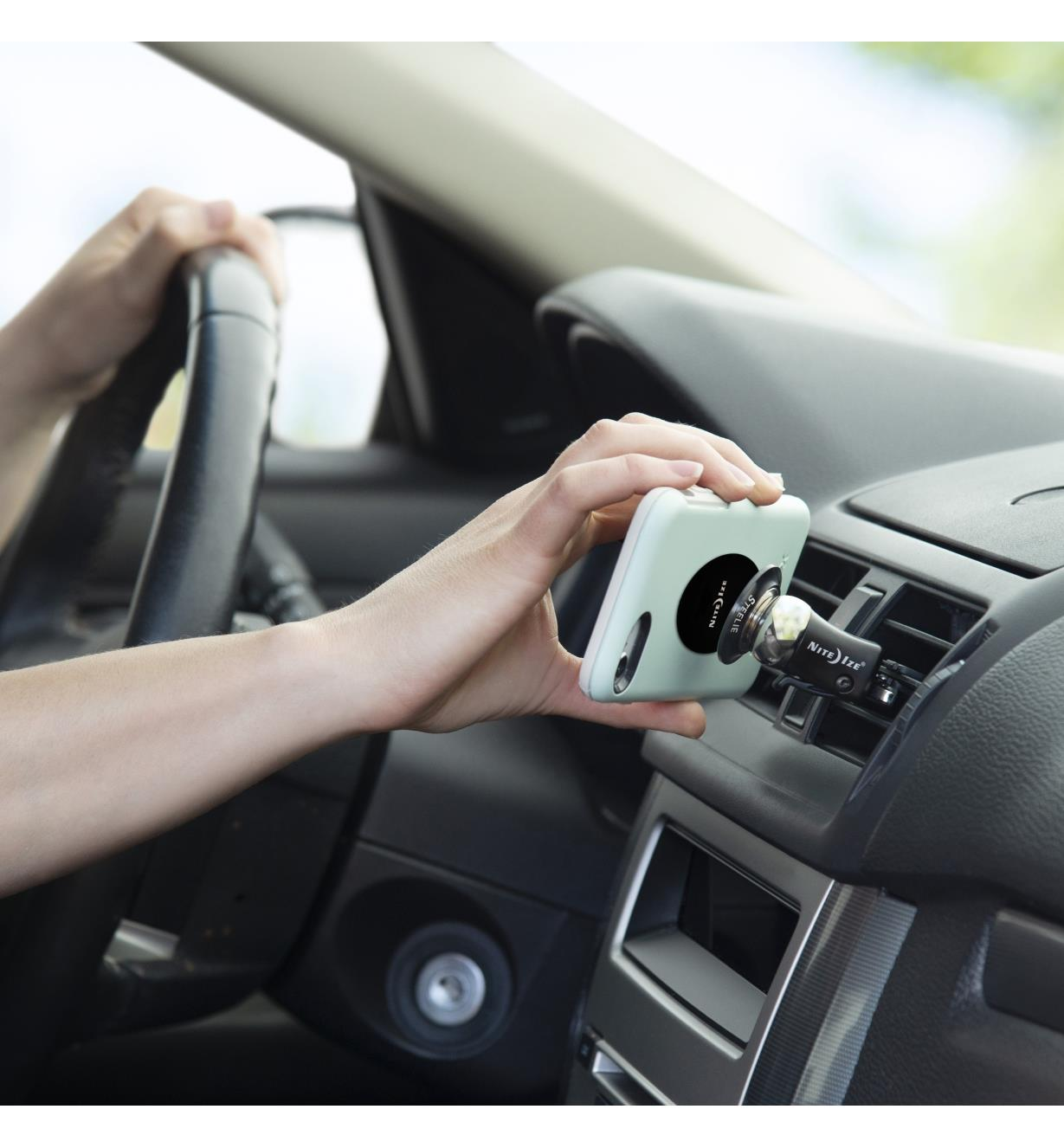 Attaching a cell phone to the vent-mount kit installed in a car vent