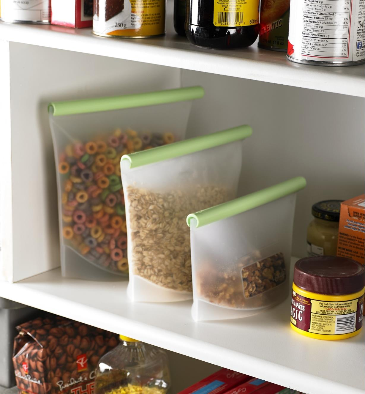 Set of 3 Reusable Silicone Bags filled with cereal in a pantry