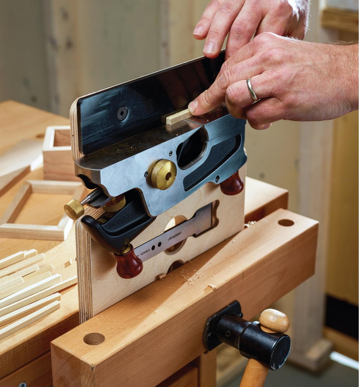 Planing a small part using a large shoulder plane in an upright hand jointer