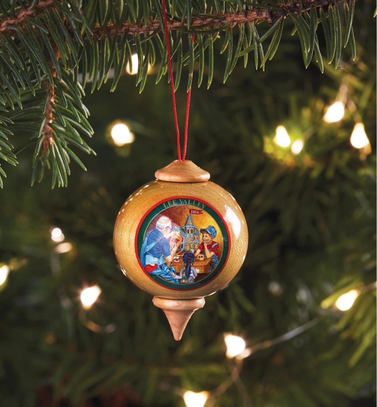 The workshop ornament hanging on a Christmas tree