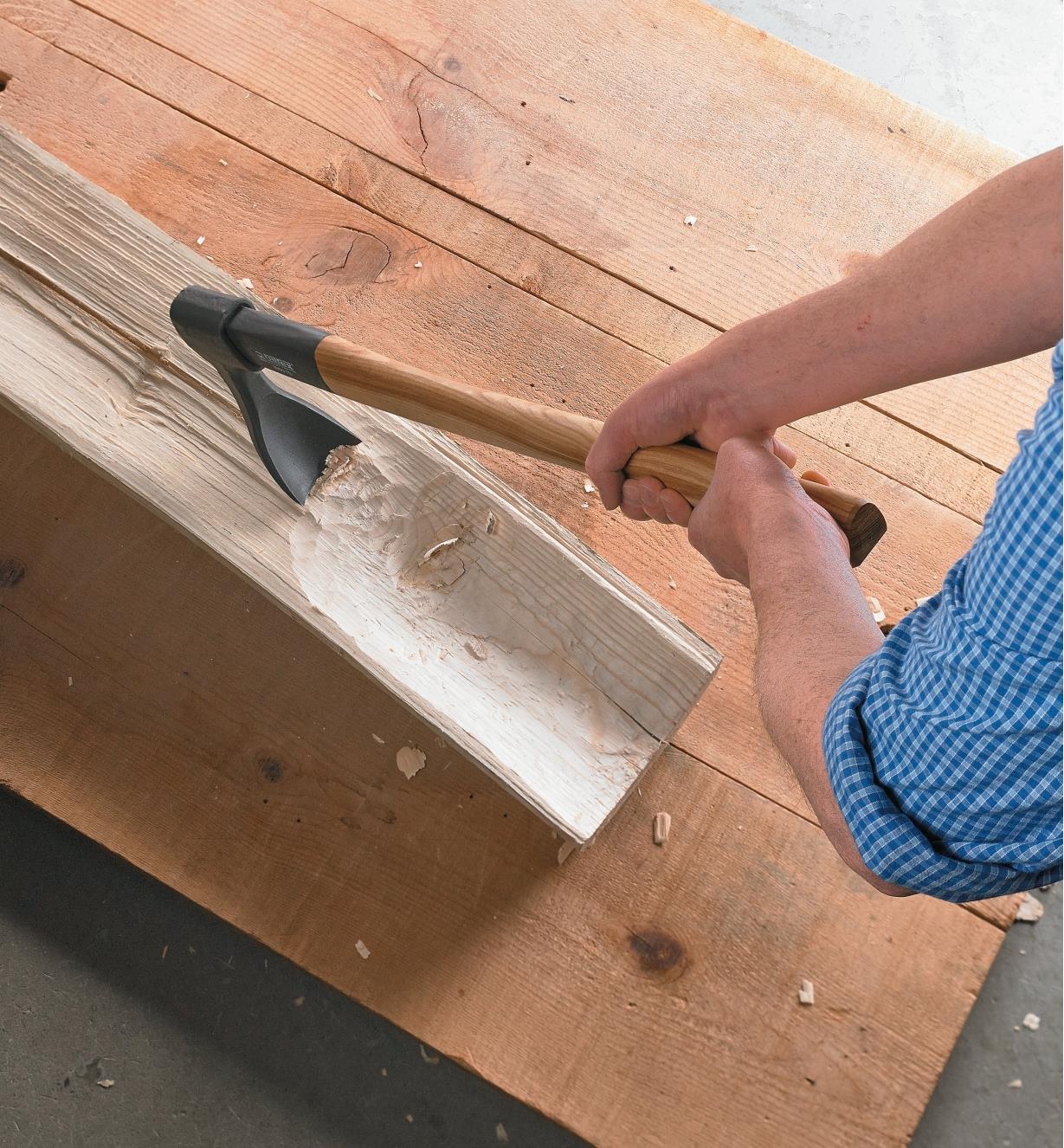 Hollowing half a log with a gutter adze