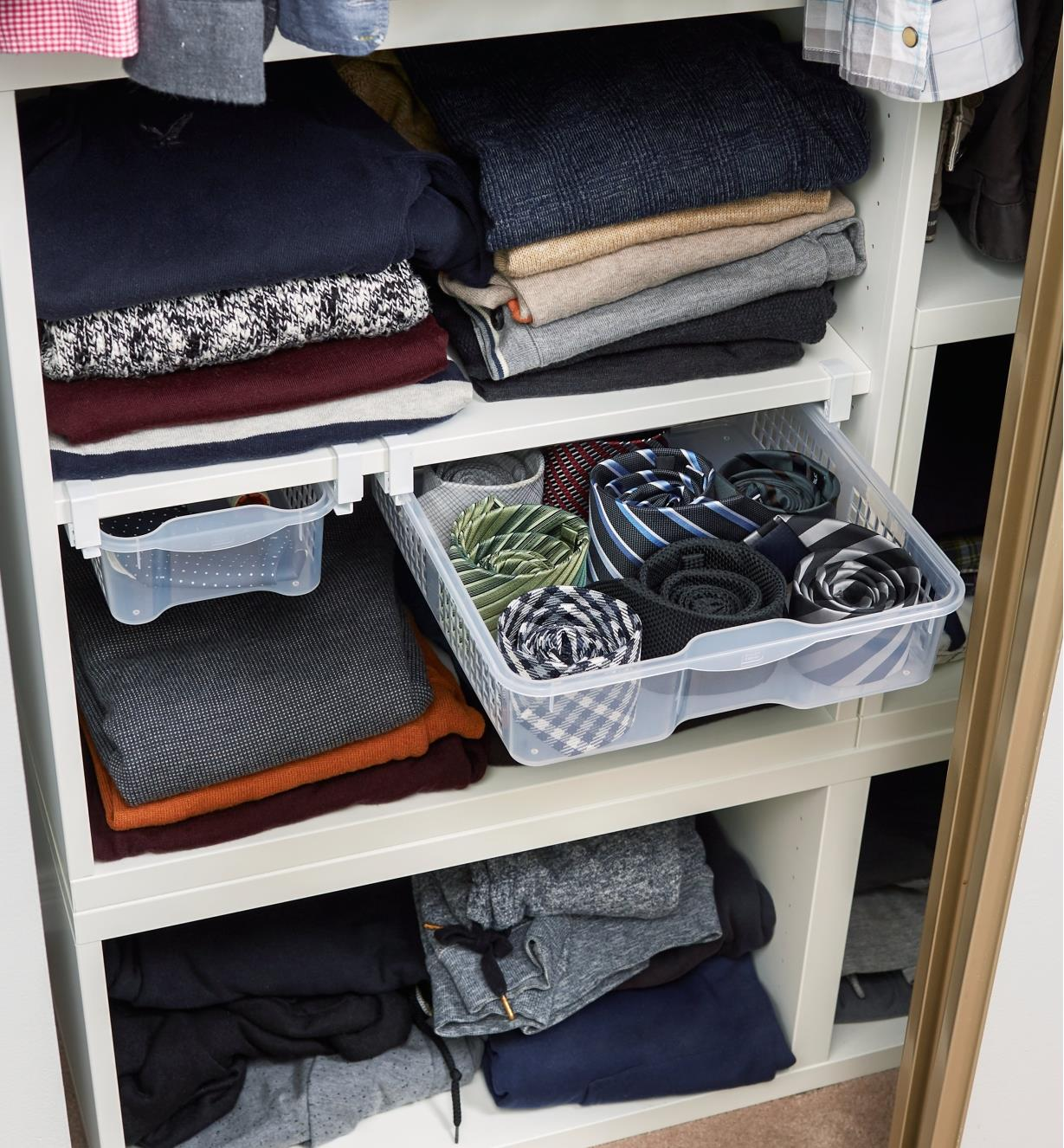 Hanging drawers installed in a closet, holding neckties