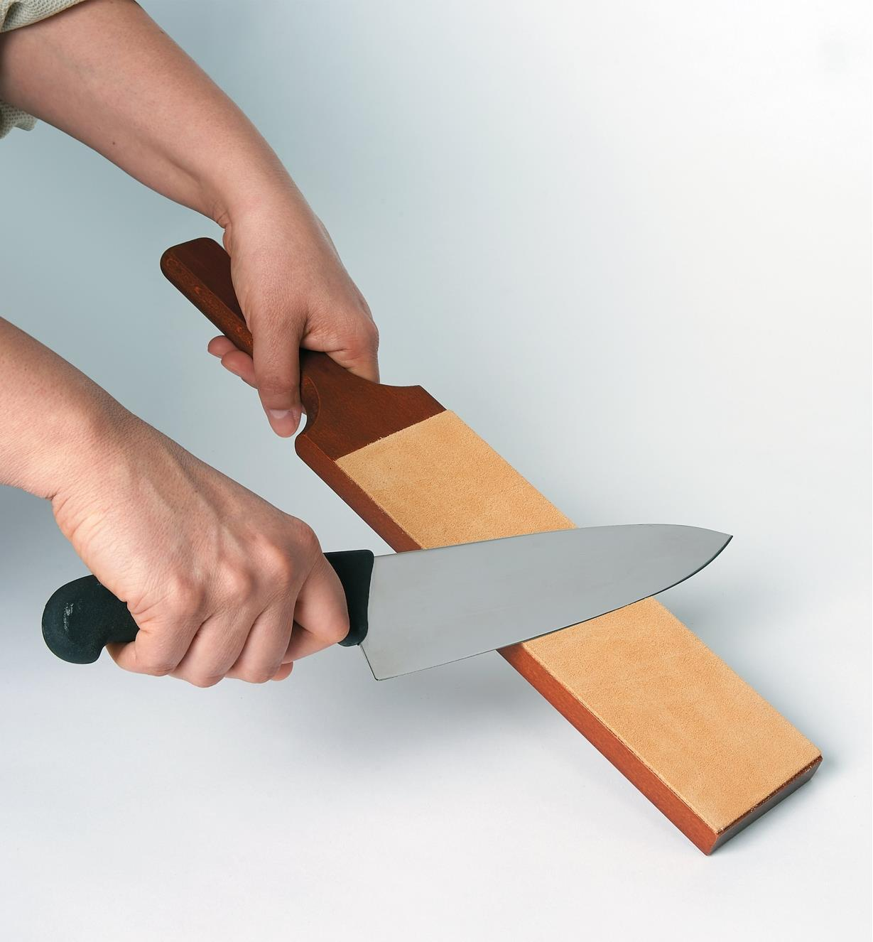 Sharpening a chef's knife on a Leather Strop