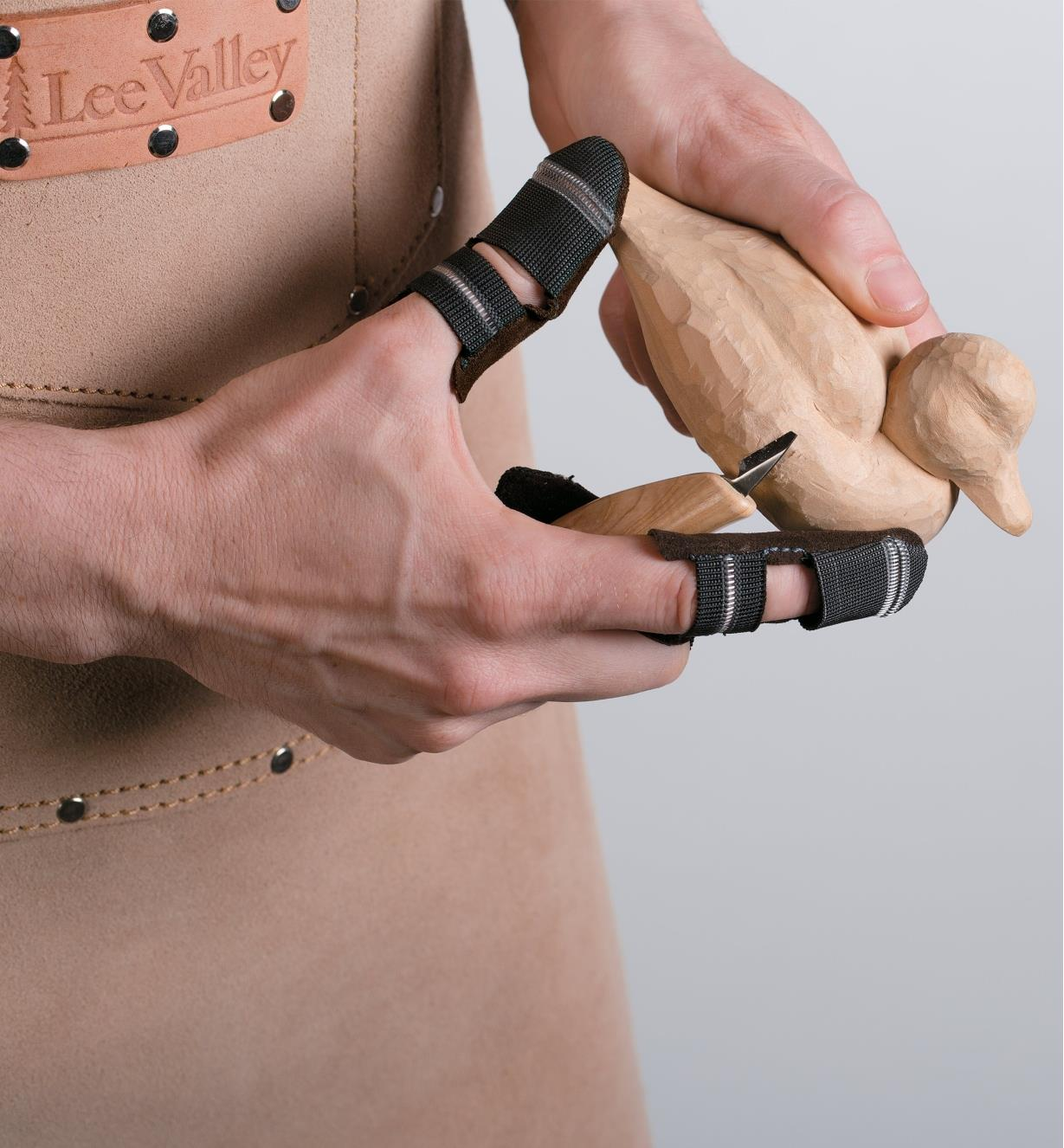 Carving a duck while wearing Leather Thumb & Finger Guards