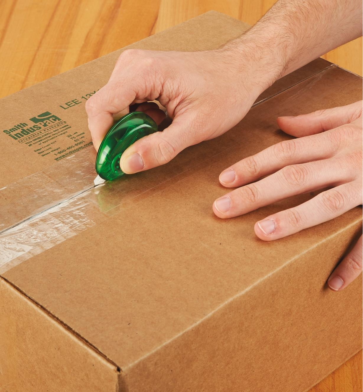 Opening a cardboard box with a Mini Utility Knife