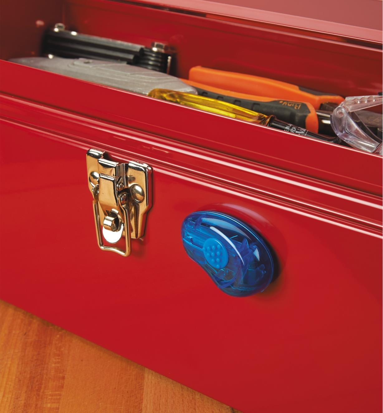 A Mini Utility Knife attached to a toolbox by its integral magnet