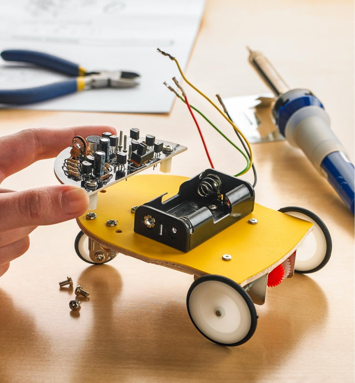 Fitting the assembled circuit board to the body of the Elenco WEmake robot car