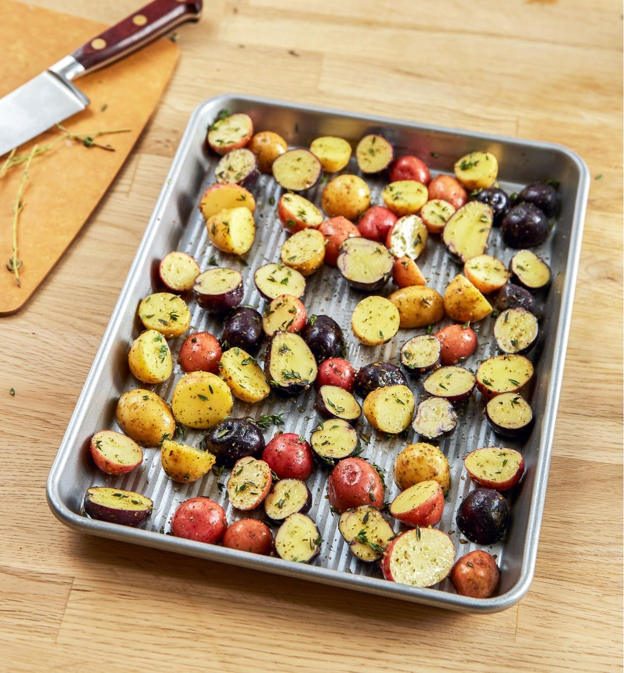 Quarter sheet baking pan containing small potatoes