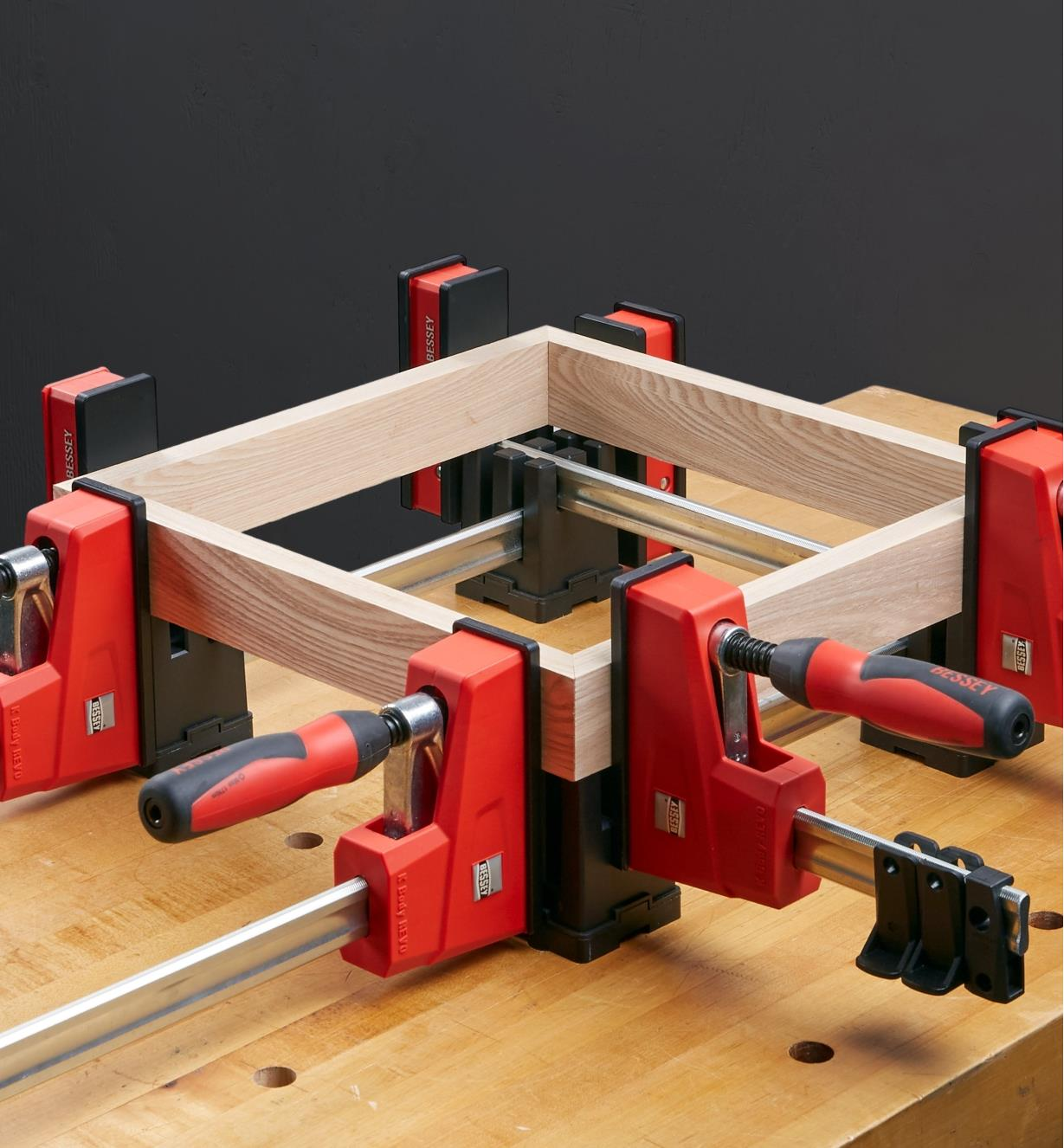 Bessey KP blocks used to hold clamps criss-crossed for holding a framing project