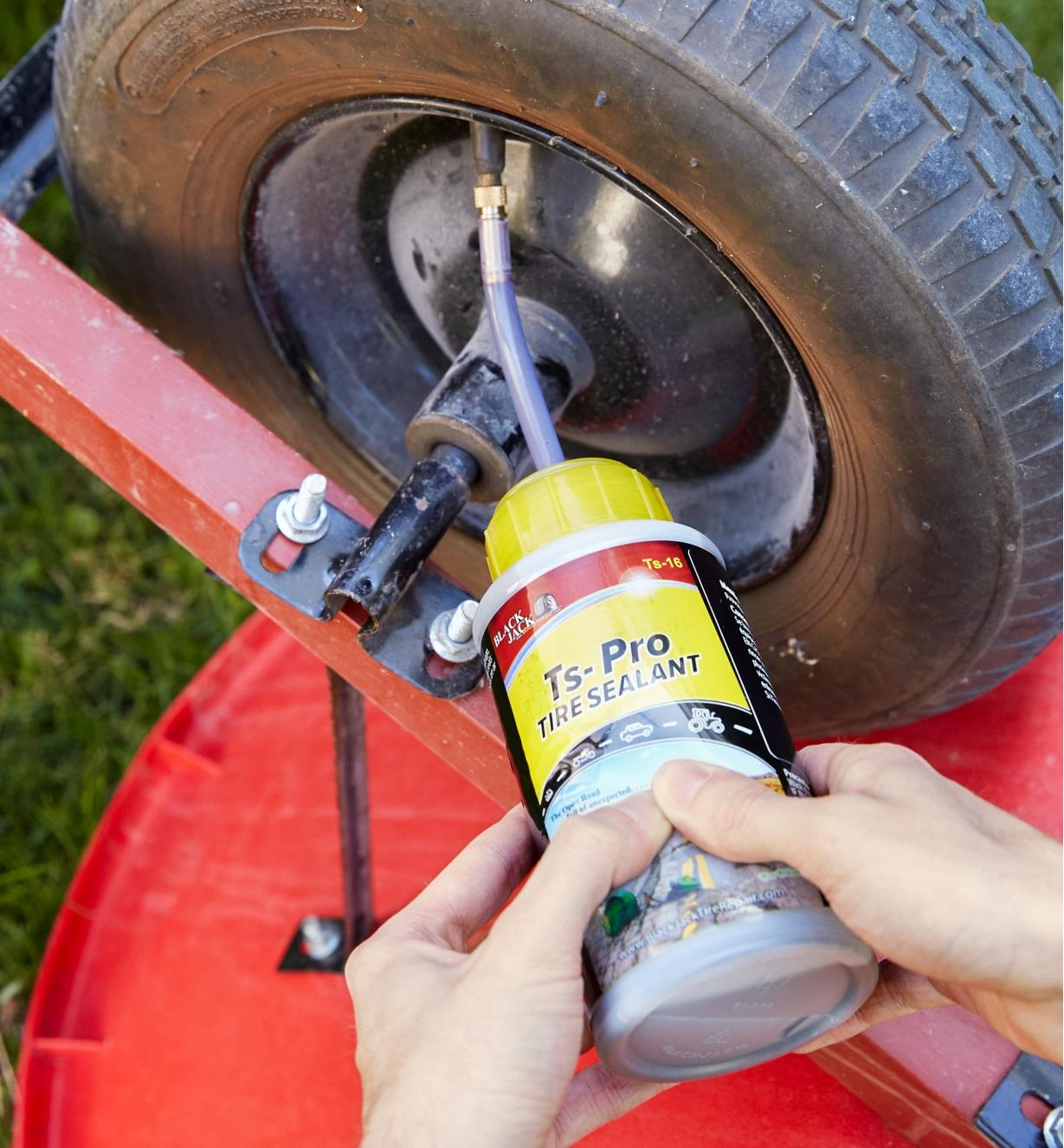 Adding Ts-Pro tire sealant to a wheelbarrow tire