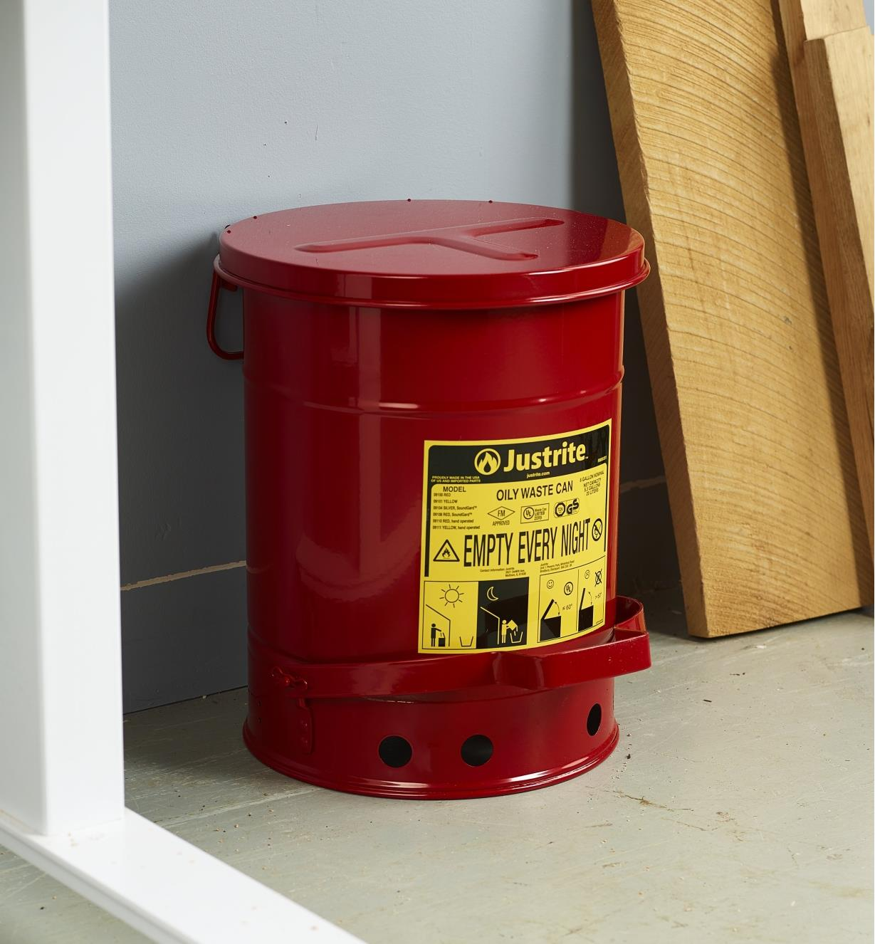 A flammable-waste can placed in a workshop