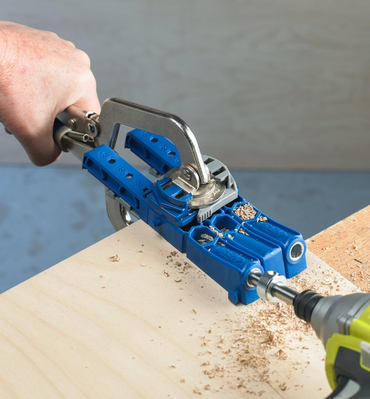A Kreg 320 pocket-hole kit being used to drill pocket holes in a piece of wood