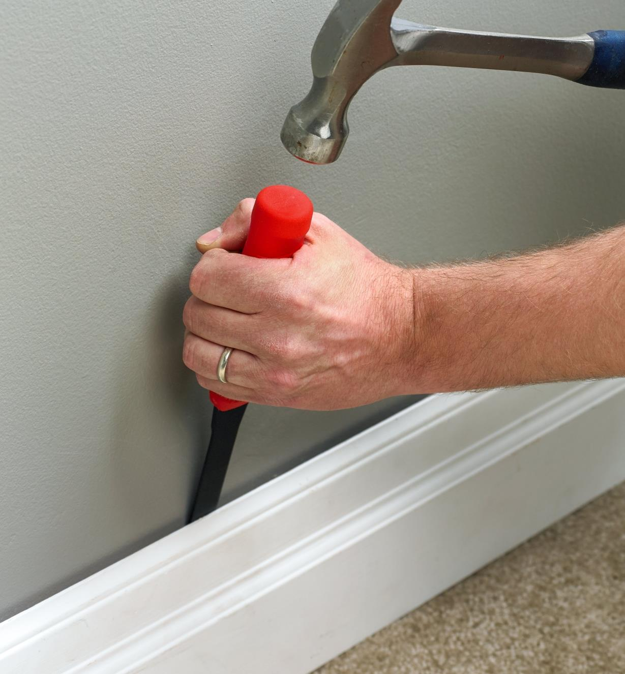 Removing  baseboard using a Hultafors holster chisel