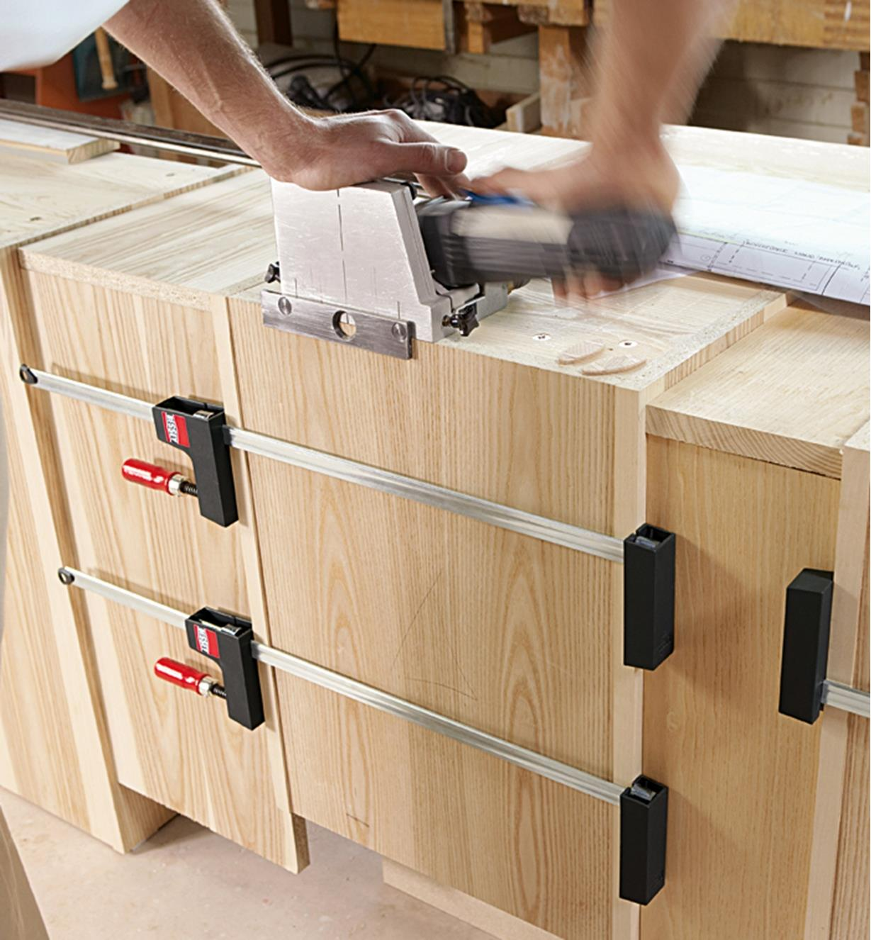 Bessey UniKlamps holding the back of a cabinet in place while the top is being built