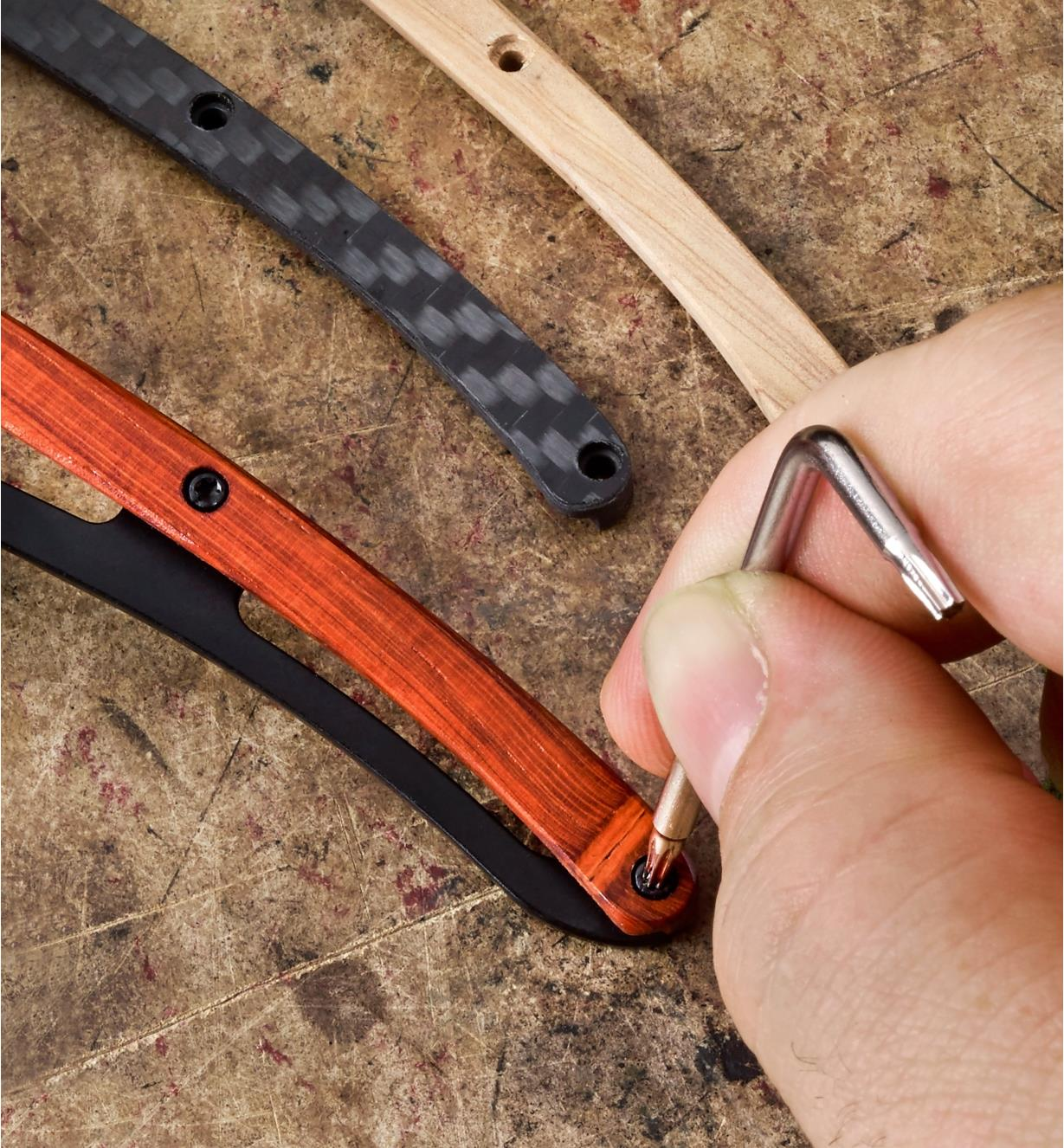The personalized knife kit being assembled using the included padauk handle scale