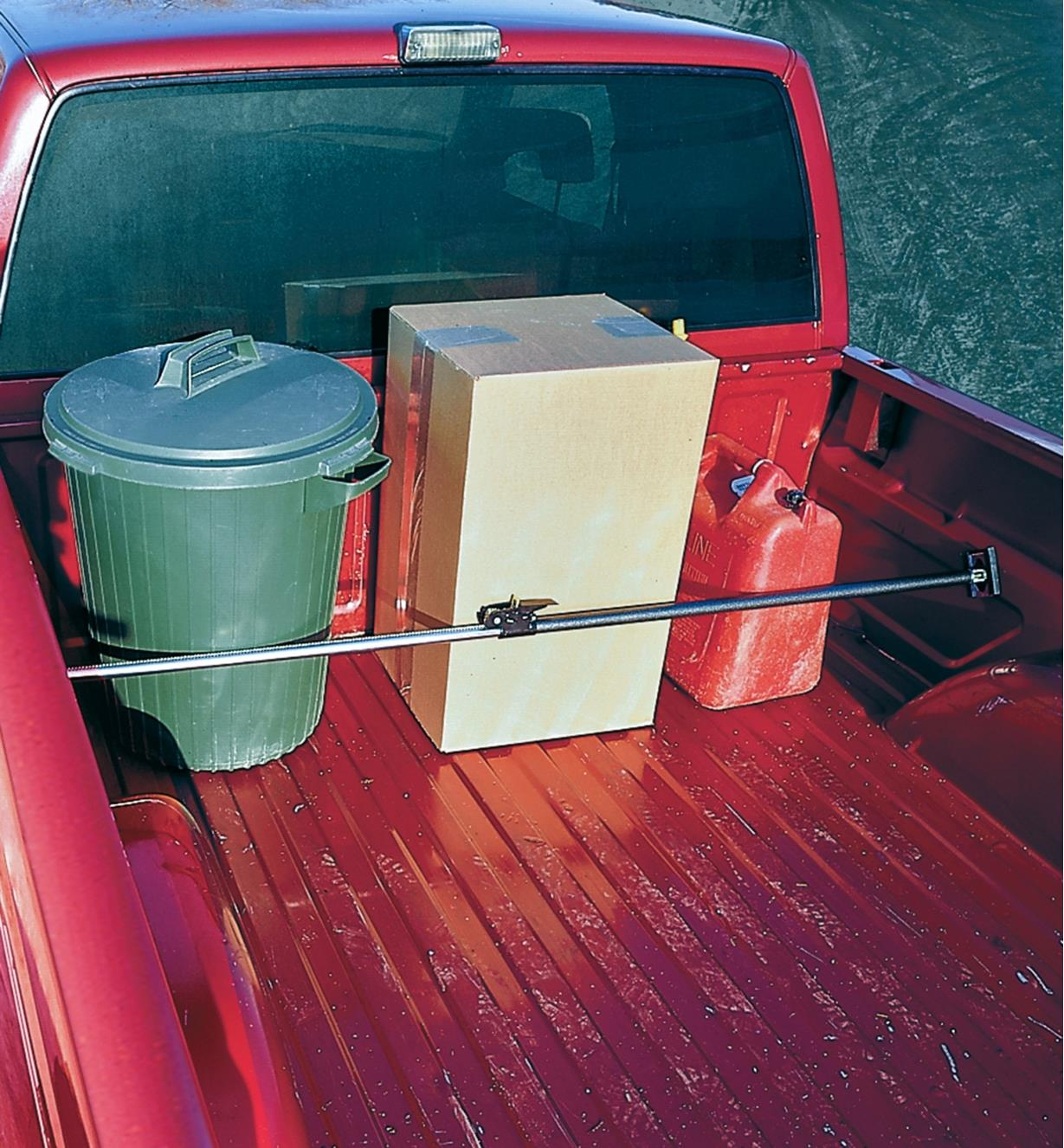 Cargo bar used to secure items in a pickup truck bed
