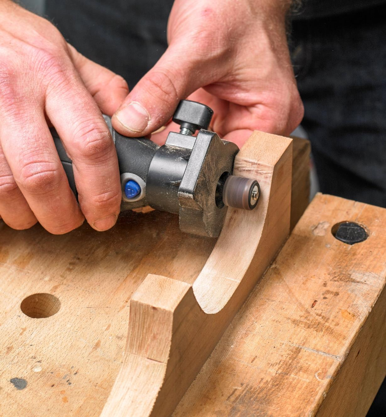 Sanding a contoured workpiece using the Dremel 3000 rotary tool with the shaping platform attachment