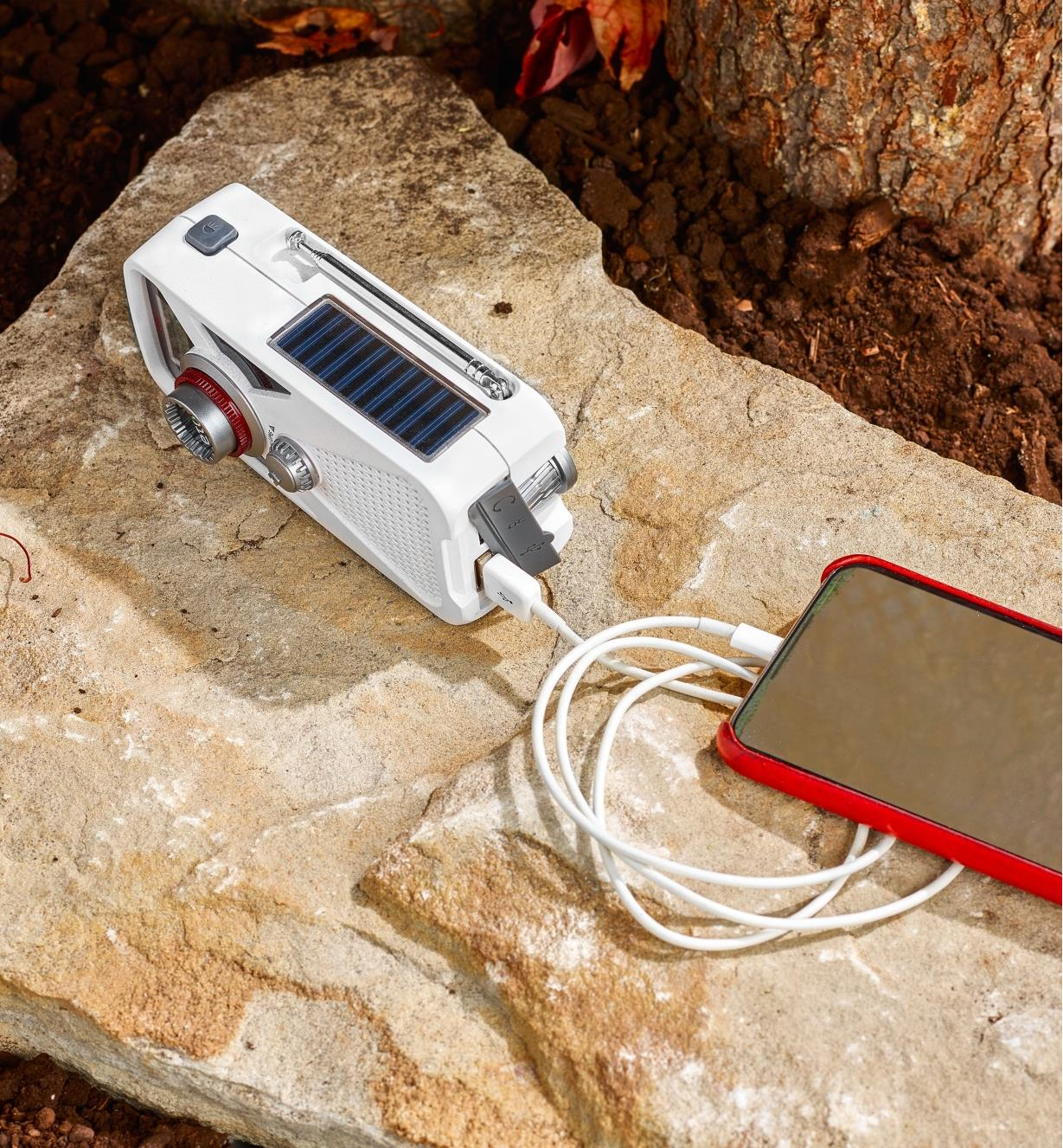 Eton emergency weather radio using solar power to charge a cell phone