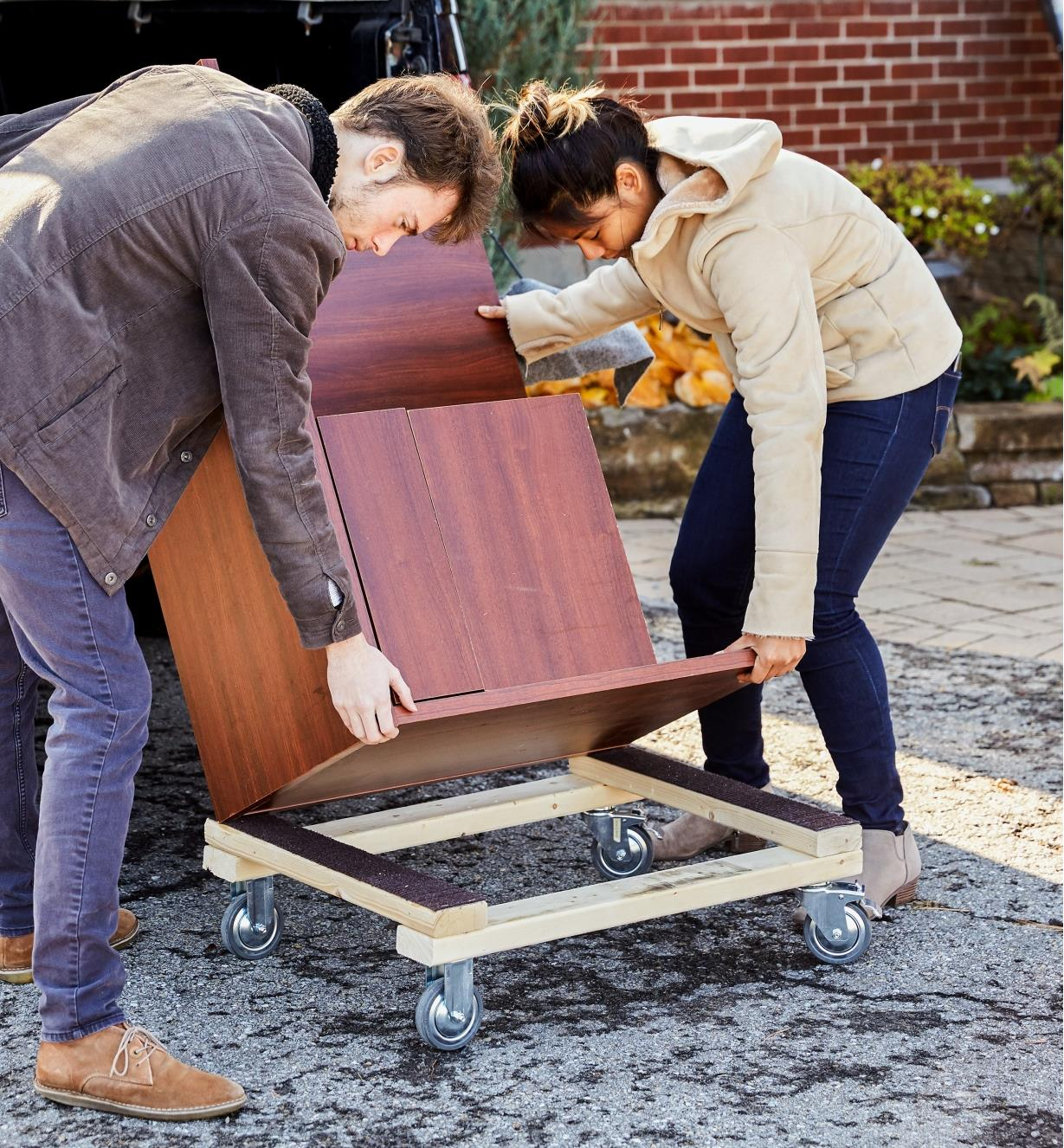 Lifting furniture off a dolly that has heavy-duty casters