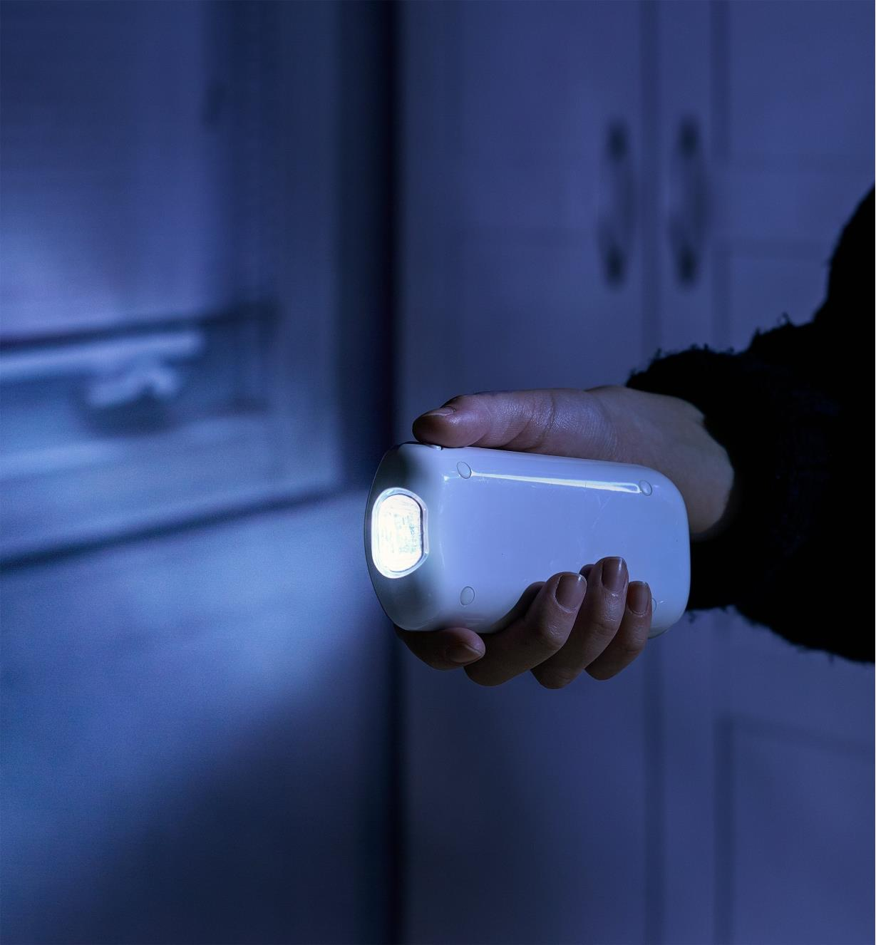 Rechargeable LED nightlight/flashlight removed from its dock and used as a hand-held flashlight