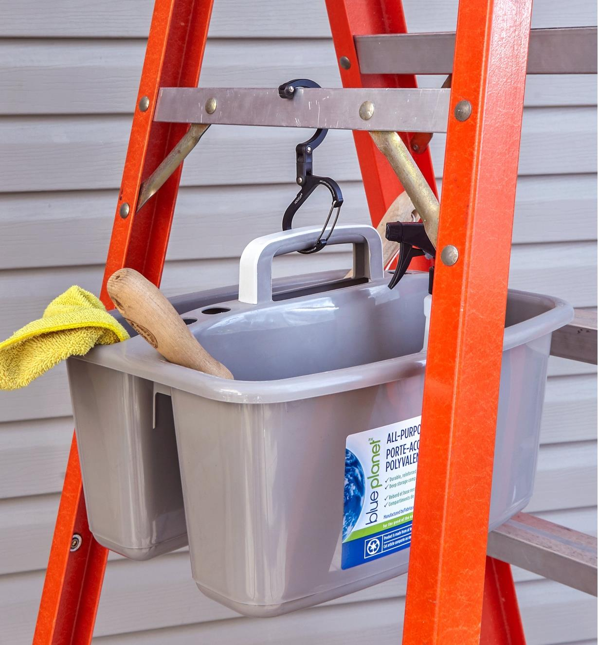 A Heroclip carabiner used to hang a bucket of cleaning supplies on a ladder