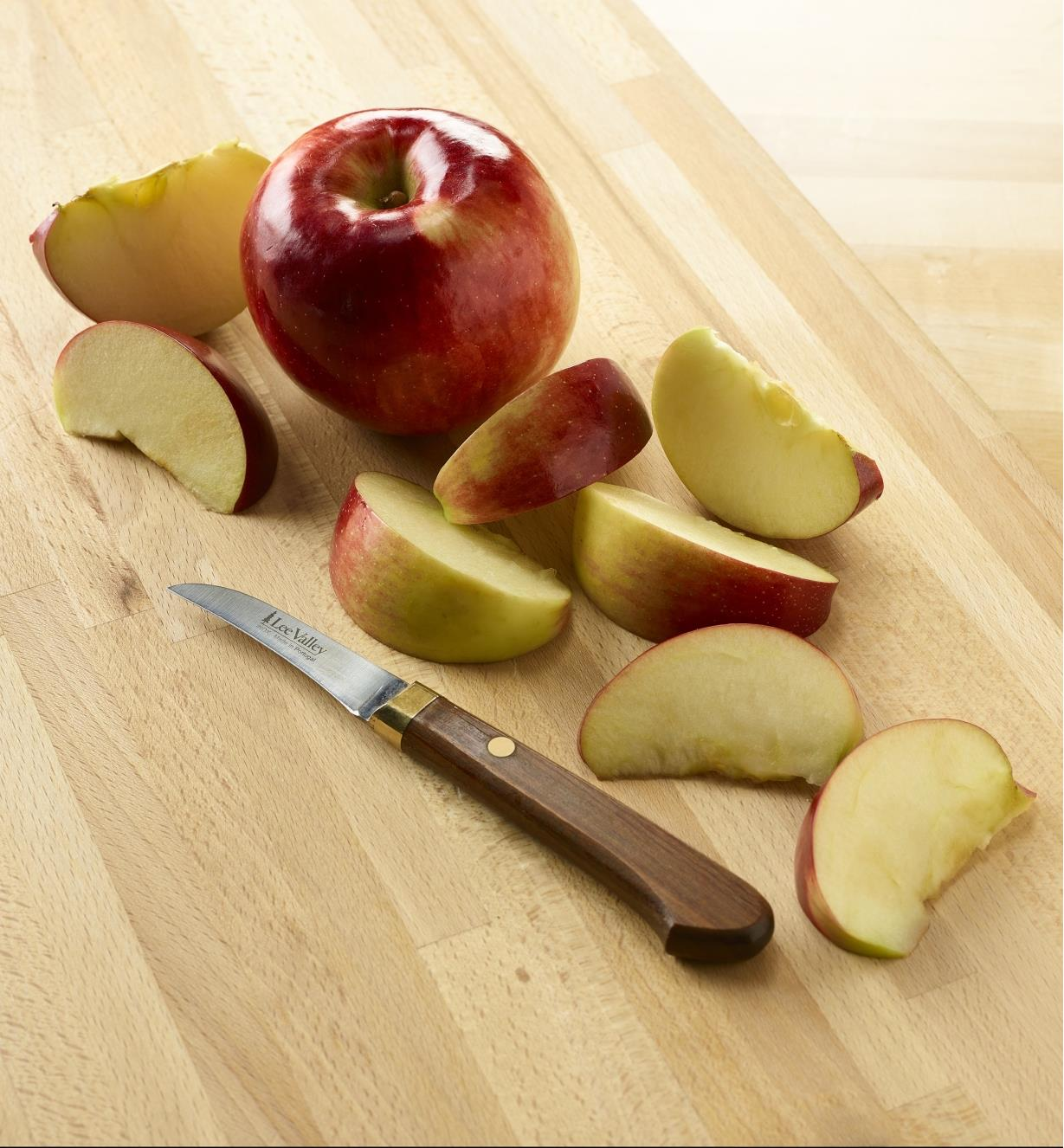 Stainless-Steel Paring Knife on a cutting board beside sliced apples