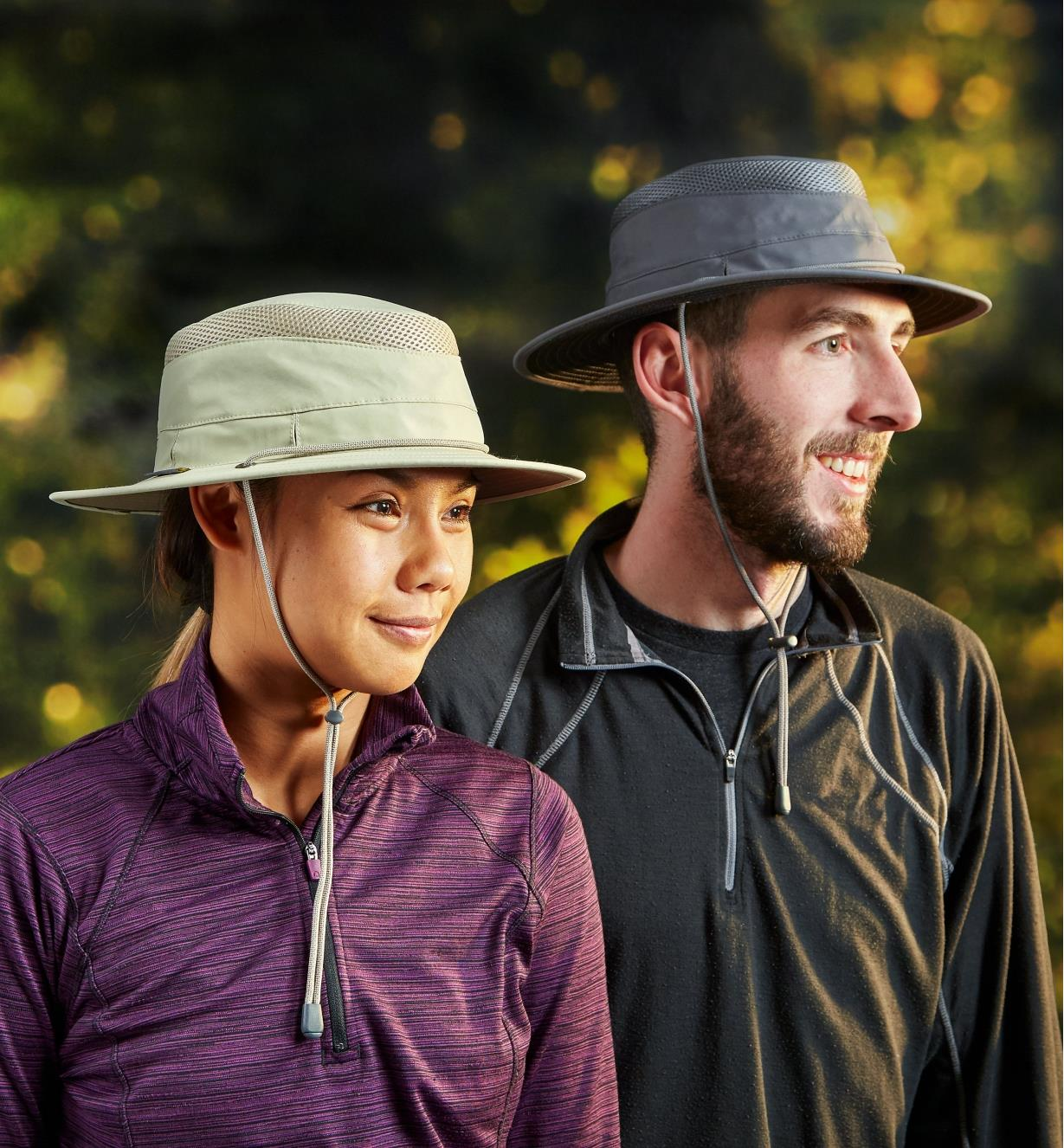 A man and a woman each wearing a classic travel hat