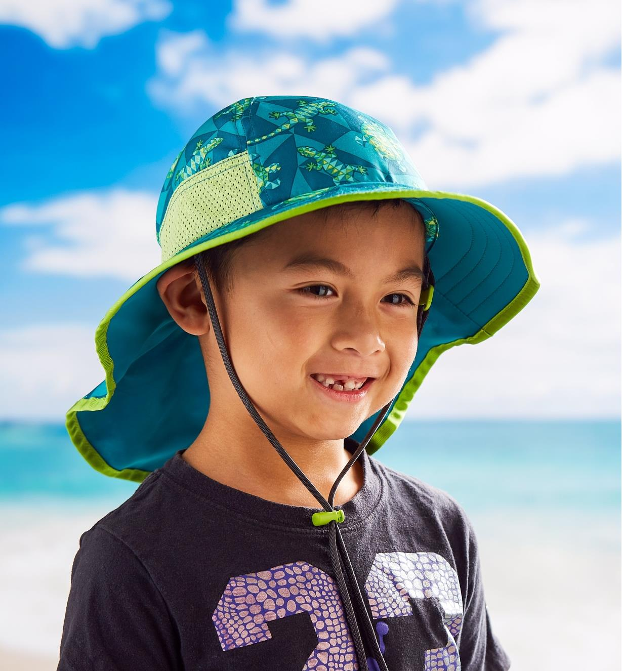 Boy wearing a kids' play hat