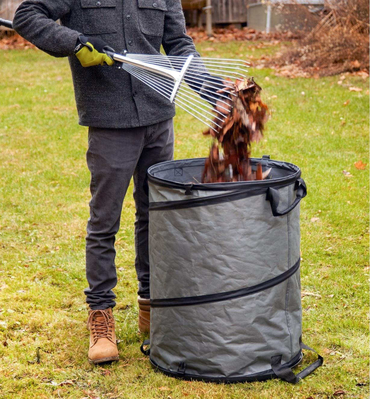 Filling the hard-bottom pop-up tote with yard waste