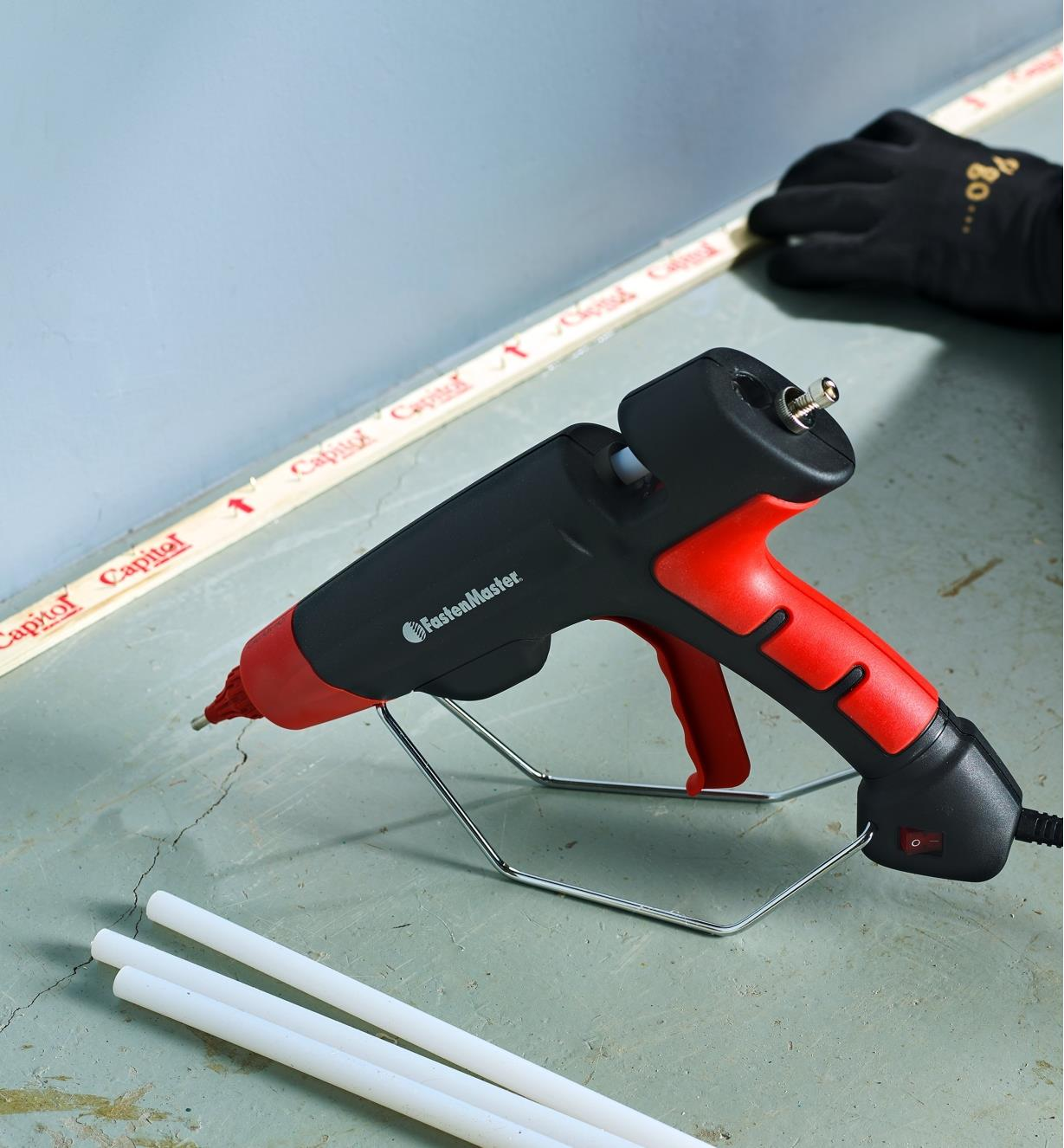 Flex 40 used with a FastenMaster pro hot-melt gun to mount carpet tack strips on a concrete floor