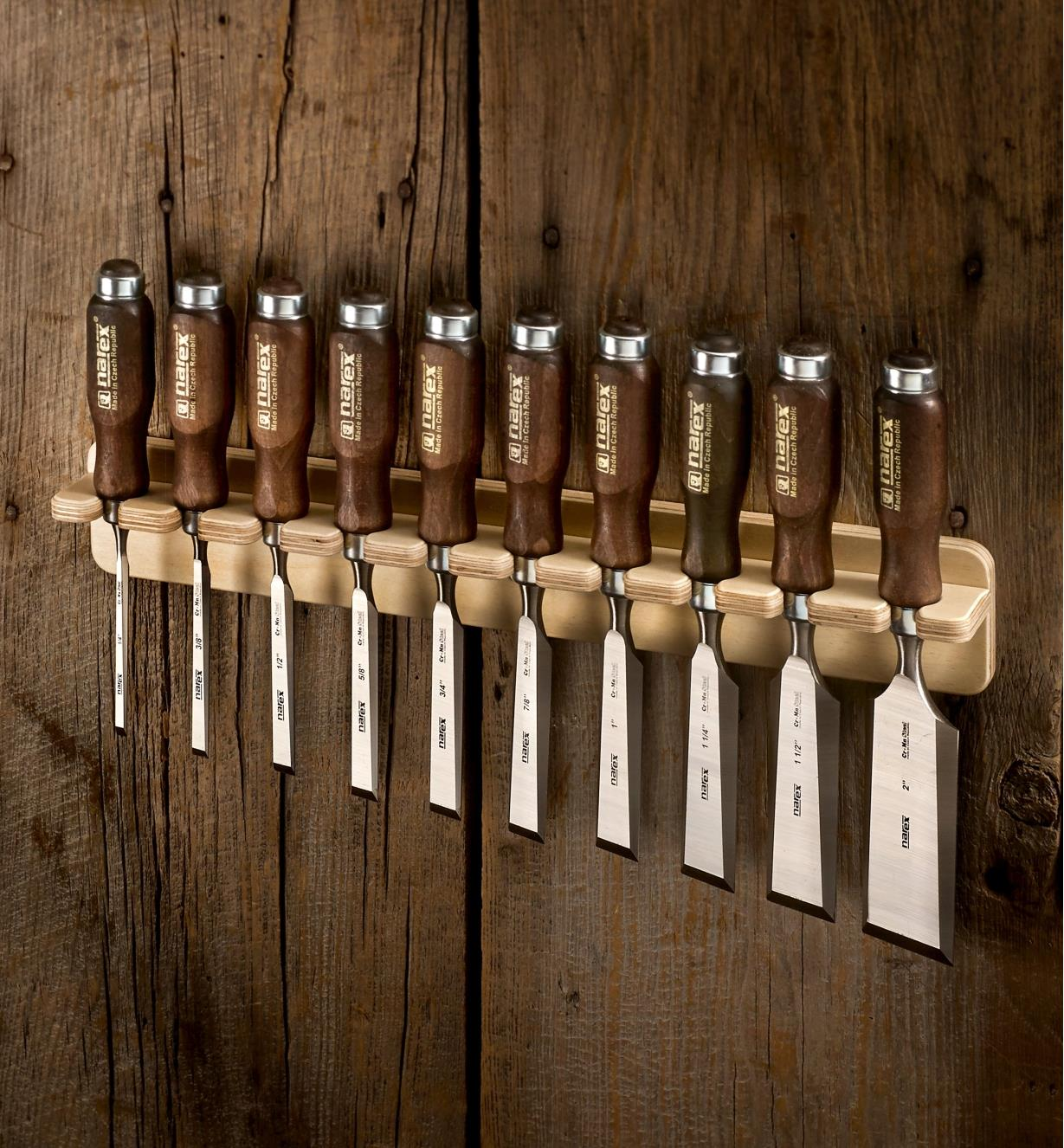 A set of ten Narex bevel-edge chisels held in a wall-mounted rack