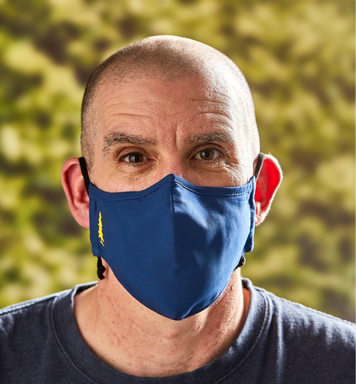 A front view of a man wearing a Lee Valley face mask