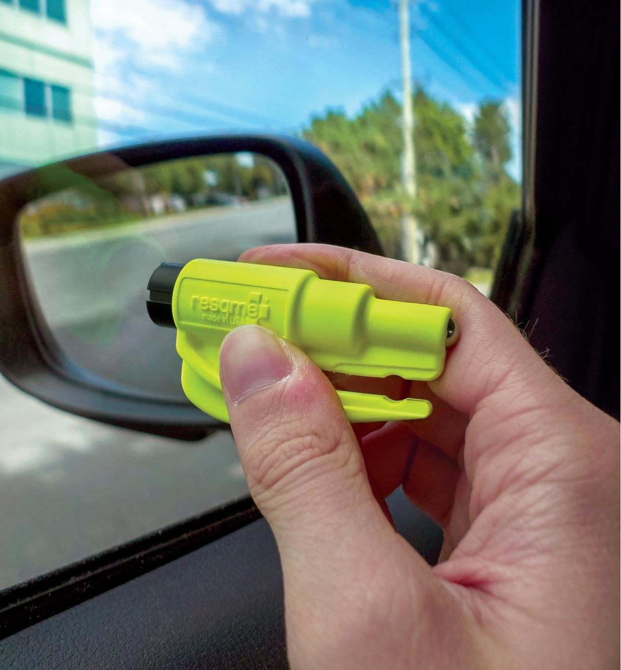 Breaking a car window with the resqme Car Escape Tool