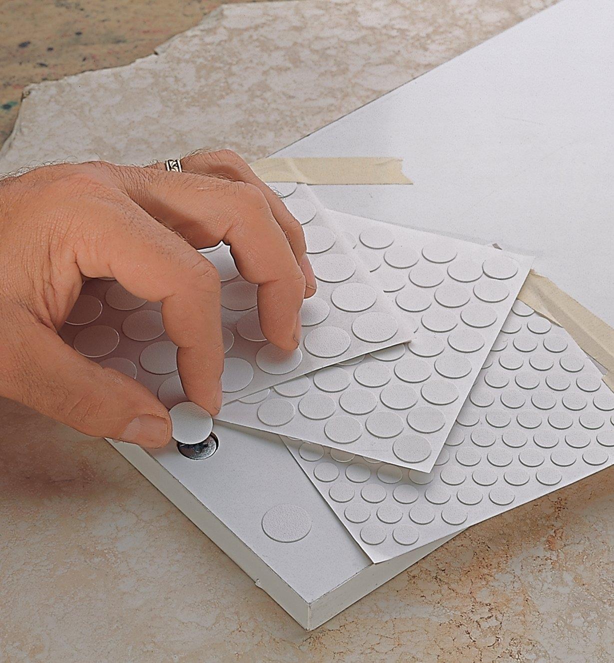 Placing a PVC Screw Cover over a screw head