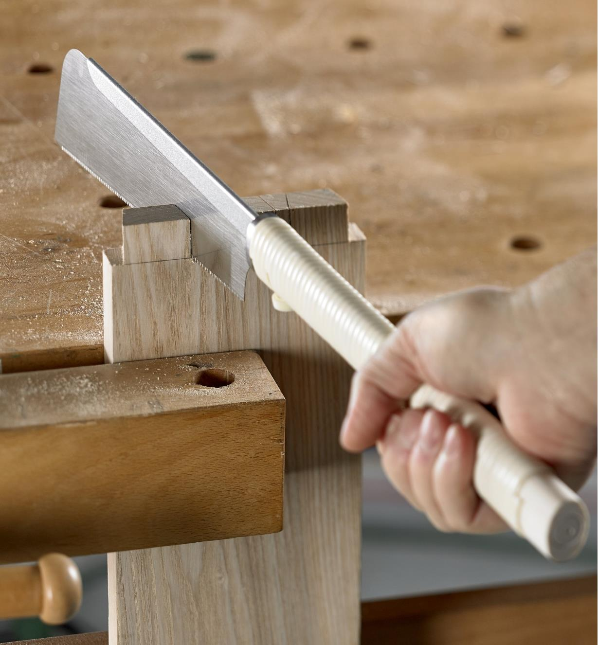 Using a dozuki to cut the pin sockets on the tail piece of a dovetail joint