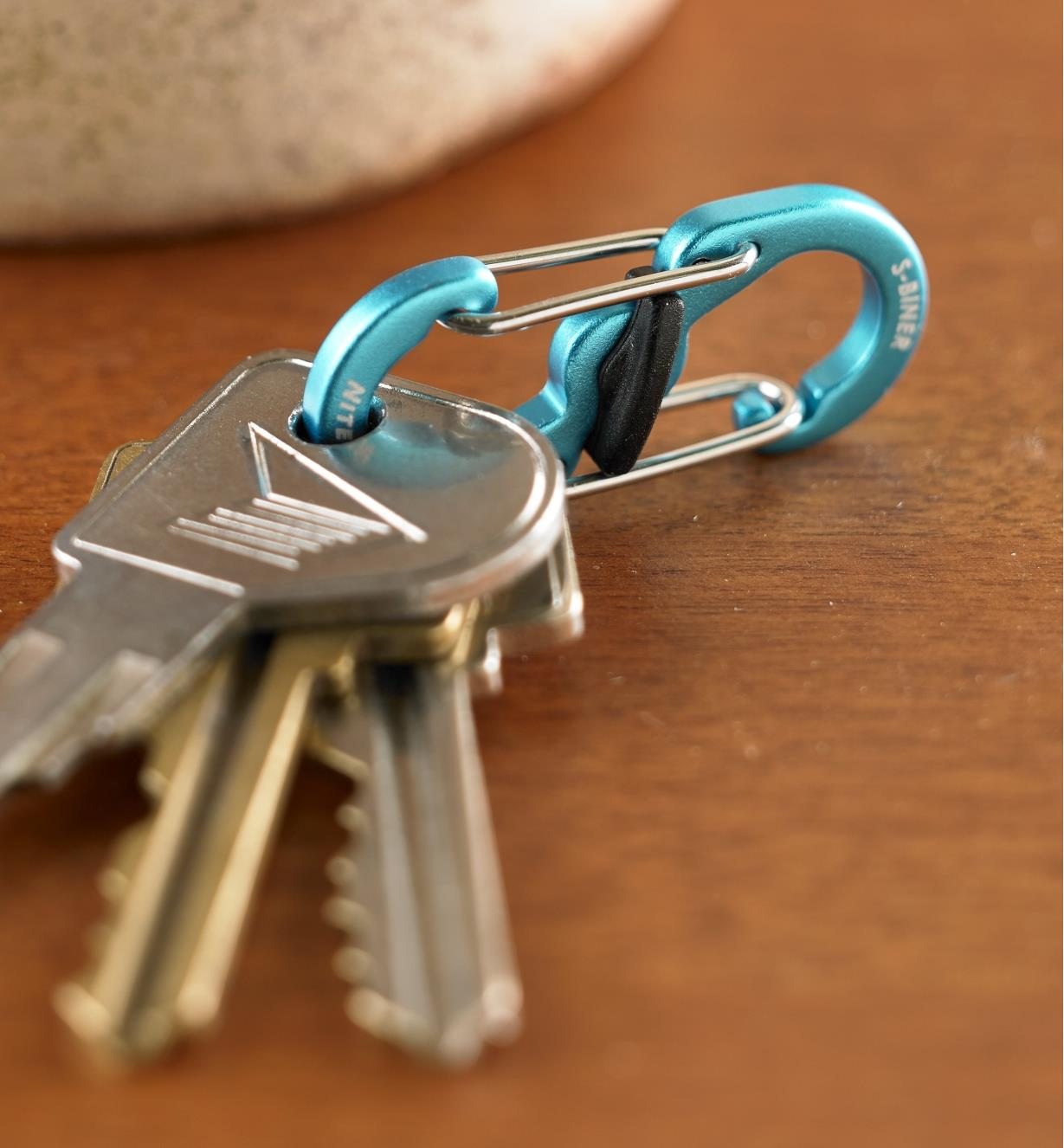 A close view of three keys on an S-Biner MicroLock aluminum key carrier