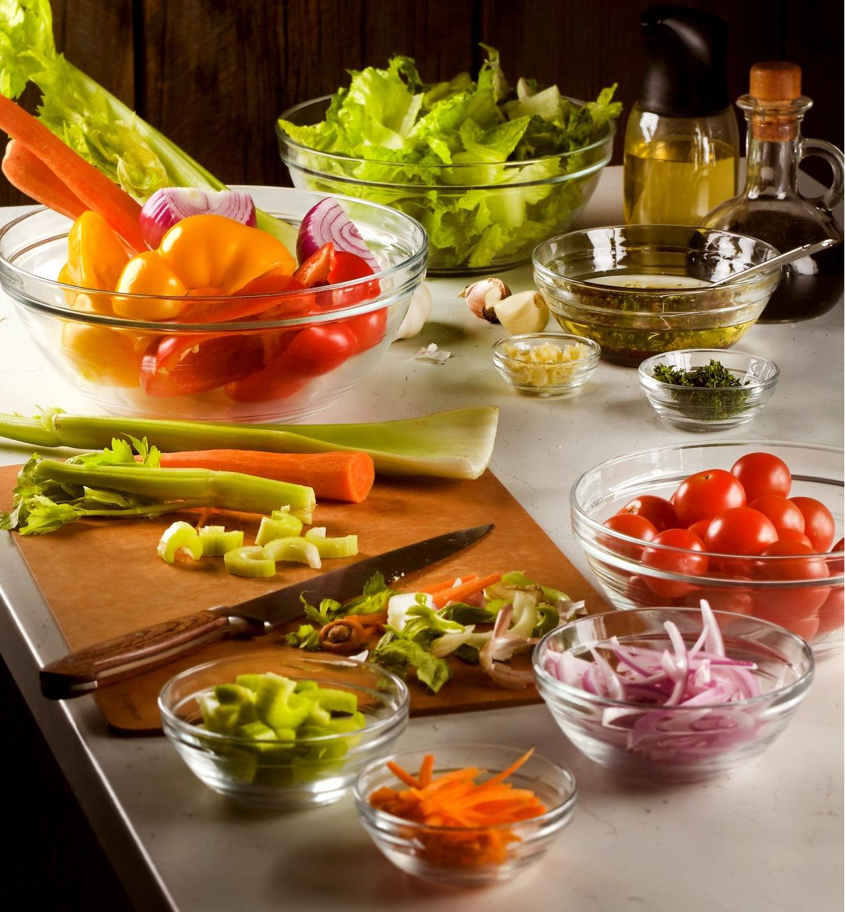 Various sizes of Duralex glass bowls used as prep bowls to hold oil and chopped vegetables