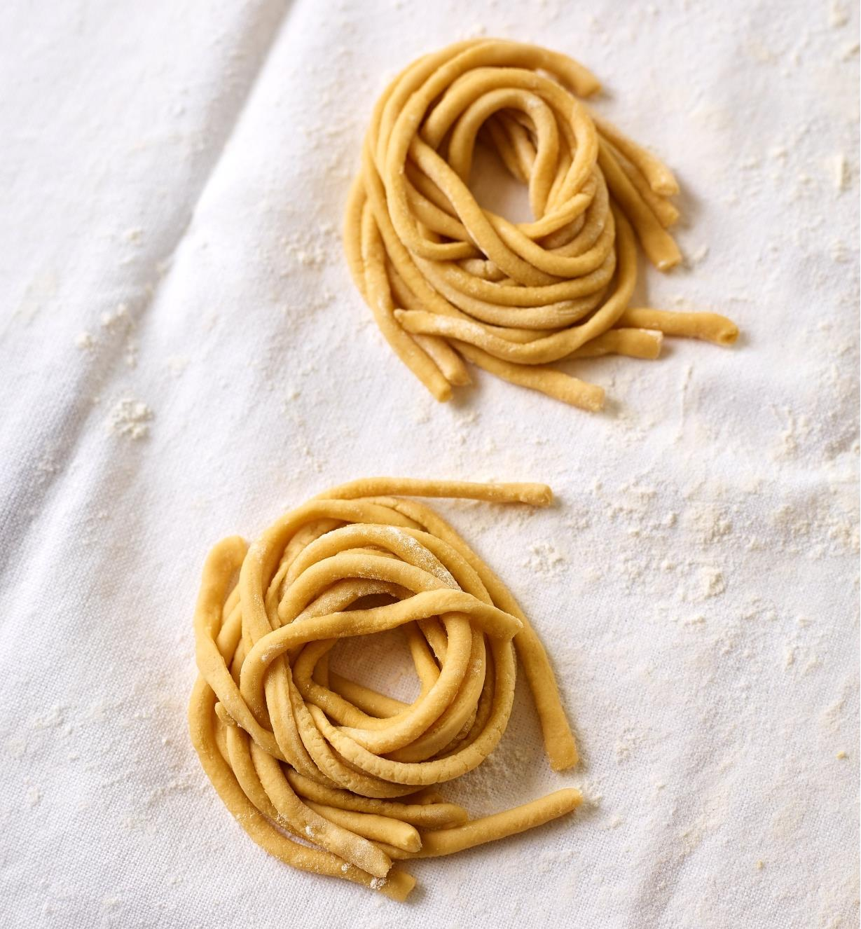 Fresh bucatini noodles made with the Marcato Pasta Extruder