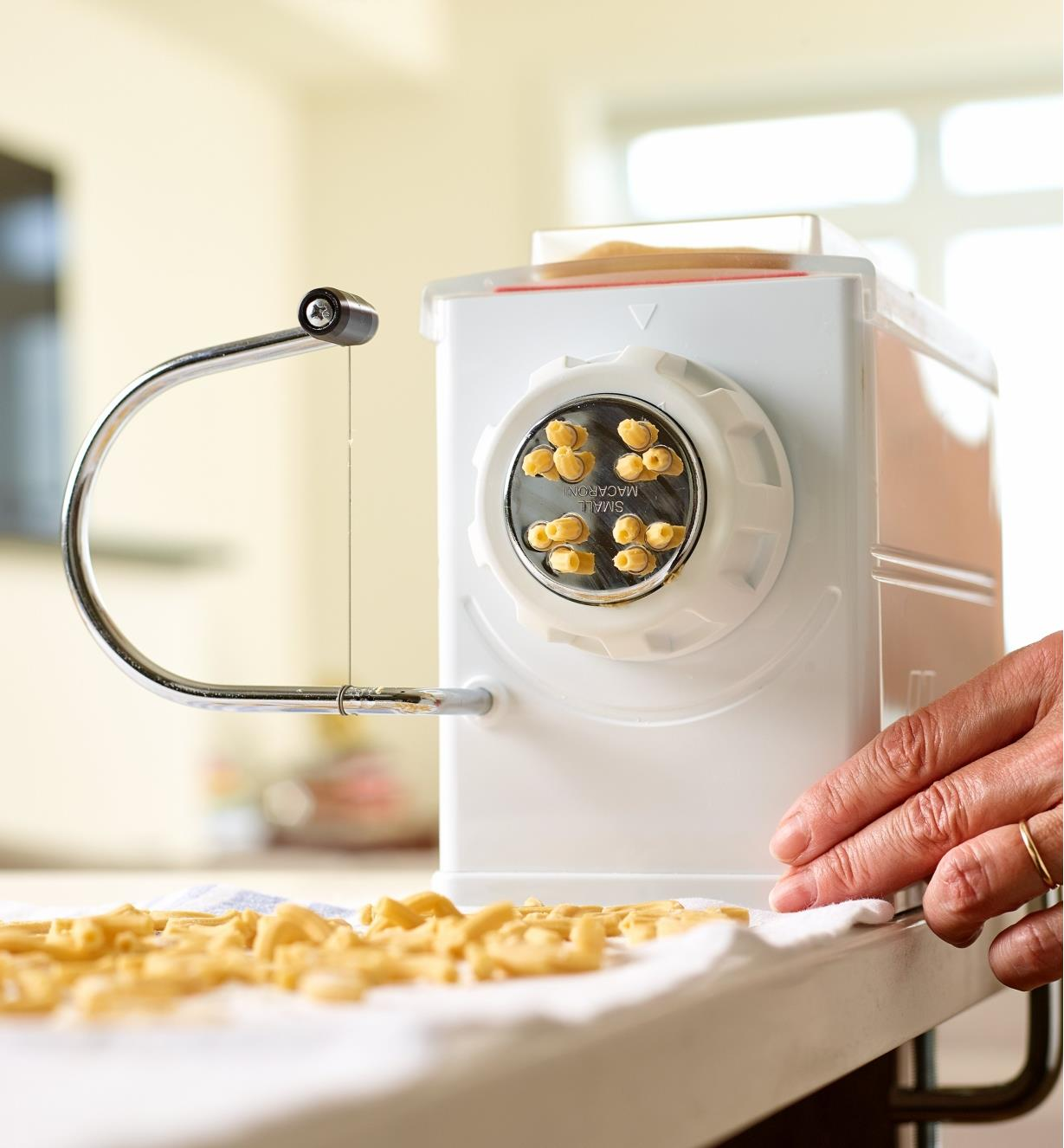 Fresh macaroni noodles being made with the Marcato pasta extruder