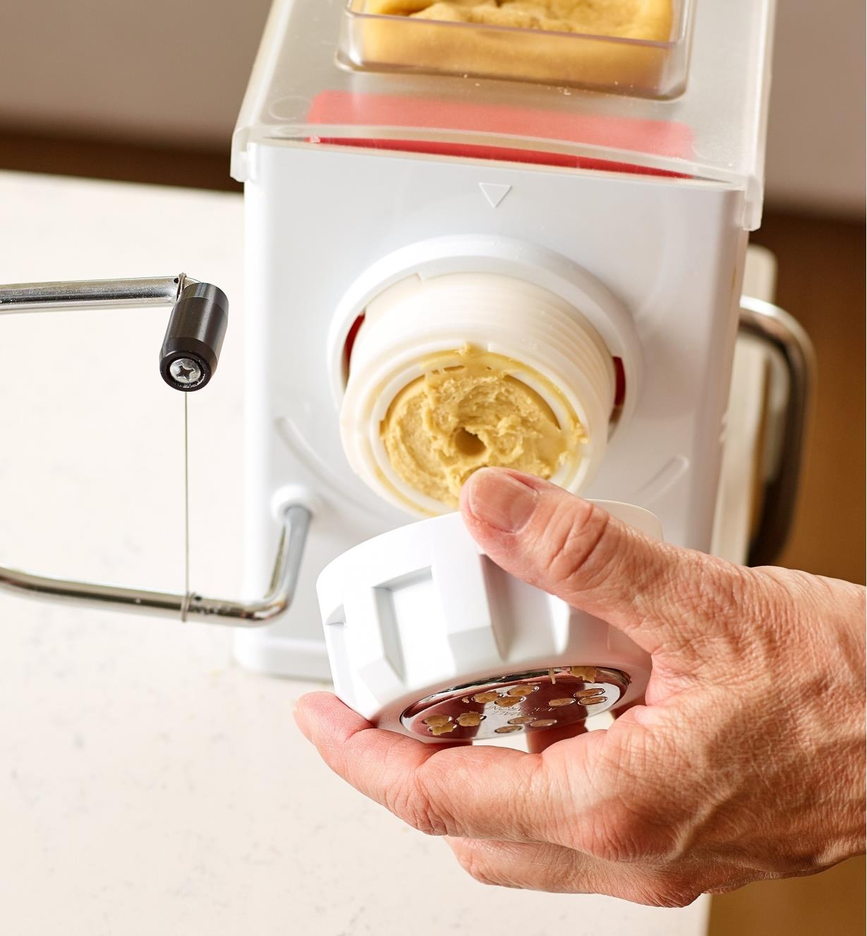 Mounting one of the interchangeable pasta dies onto a Marcato pasta extruder