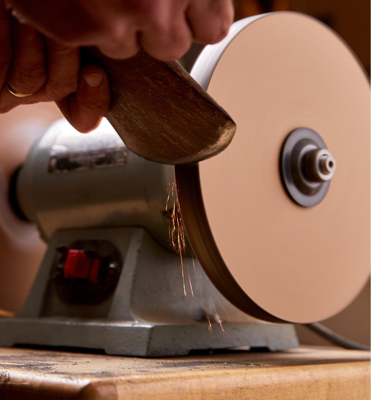 Sharpening an axe using the grit wheel of the razor sharp kit