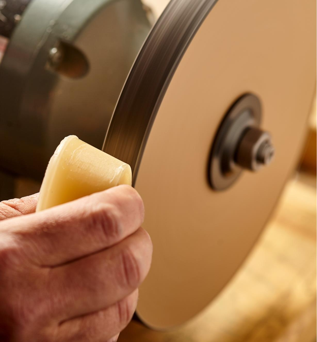 Applying conditioning wax to the grit wheel of the razor sharp kit