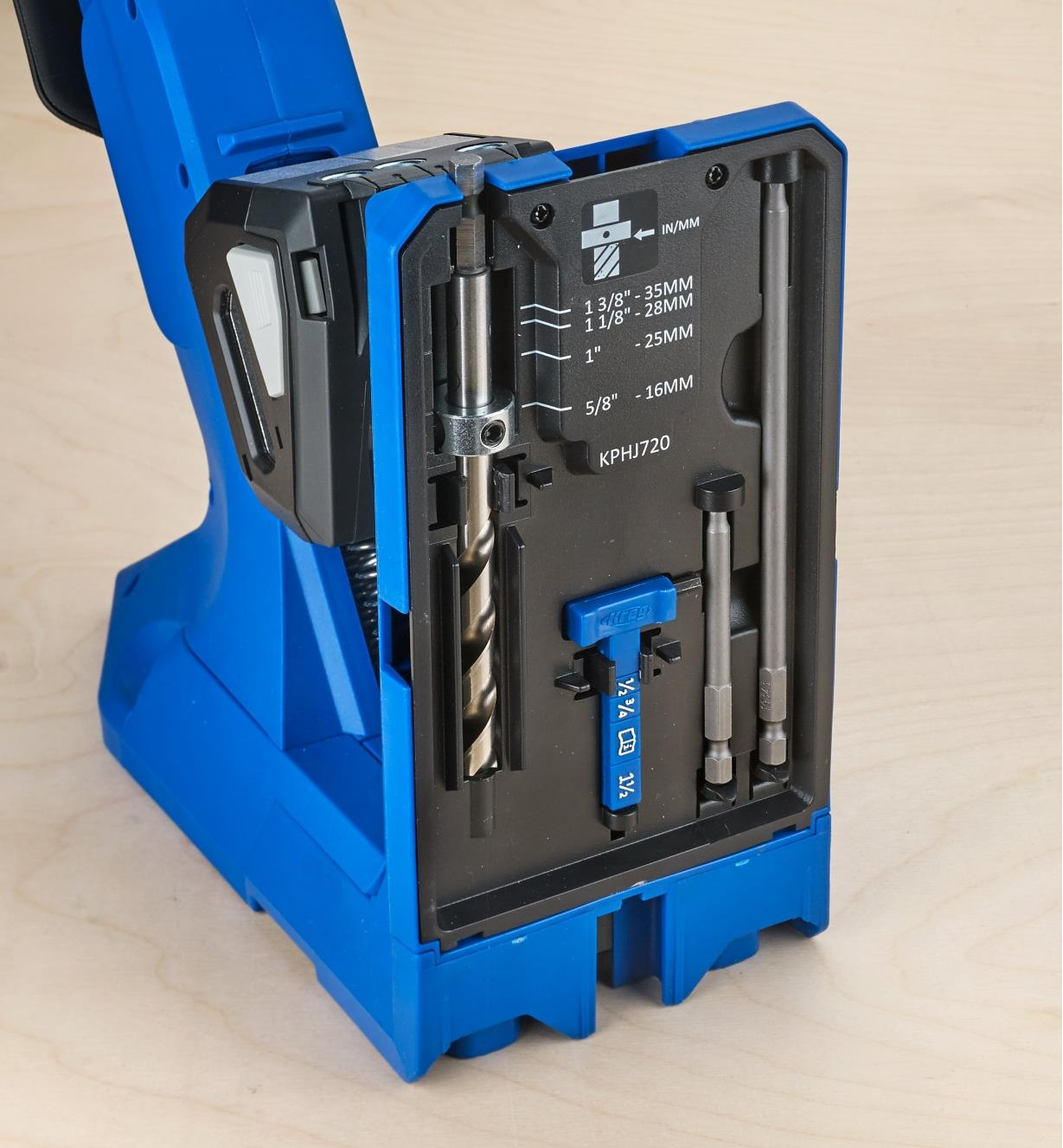 The included drill bit, driver bits and thickness gauge held in storage slots in the 720 jig base