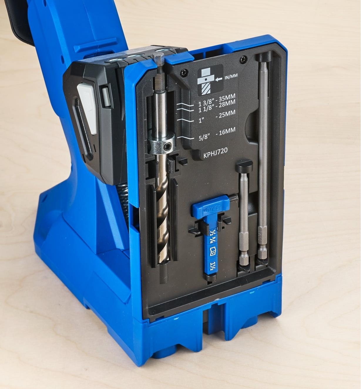 The included drill bit, driver bits and thickness gauge stored in slots in the 720 Pro jig base